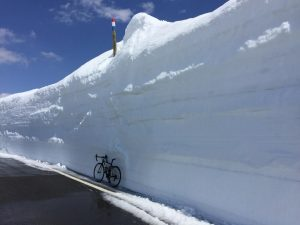 Road bike next to wall of snow